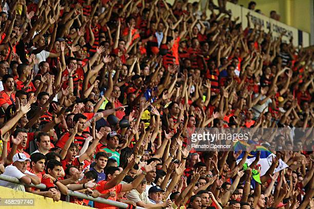 Fans of Sport Recife celebrate a pelnaty during the Brasileirao Series A 2014 match between Sport Recife and Figueirense at Ilha do Retiro Stadium on...