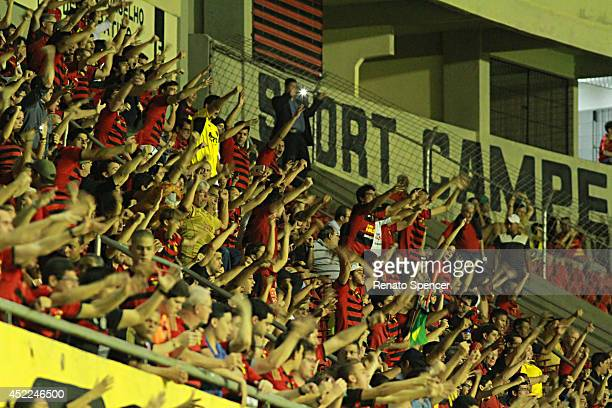 Fans of Sport Recife cheer before a match between Sport Recife and Botafogo as part of Brasileirao Series A 2014 at Ilha do Retiro Stadium on July 16...