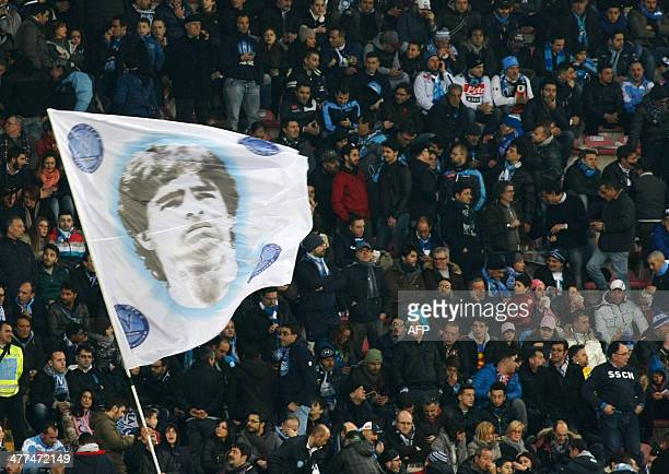 Fans of SSC Napoli wave a flag depicting former Napoli's Argentine forward Diego Armando Maradona during the Italian Serie A football match between...