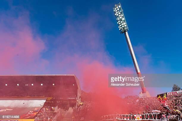 Fans of Stuttgart burn flares during the Second Bundesliga match between Karlsruher SC and VfB Stuttgart at Wildparkstadion on October 30 2016 in...