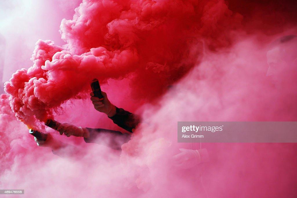 Fans of Stuttgart burn flares prior to the Bundesliga match between VfB Stuttgart and SV Werder Bremen at MercedesBenz Arena on April 12 2015 in...