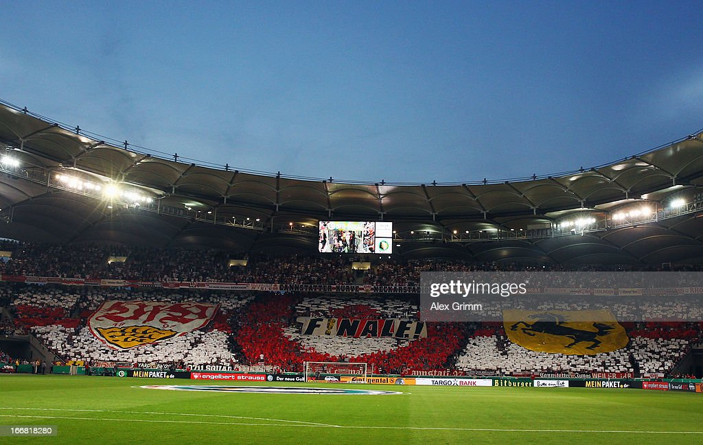 Fans of Stuttgart cheer prior to the DFB Cup Semi Final match between VfB Stuttgart and SC Freiburg at Mercedes-Benz Arena on April 17, 2013 in Stuttgart, Germany.