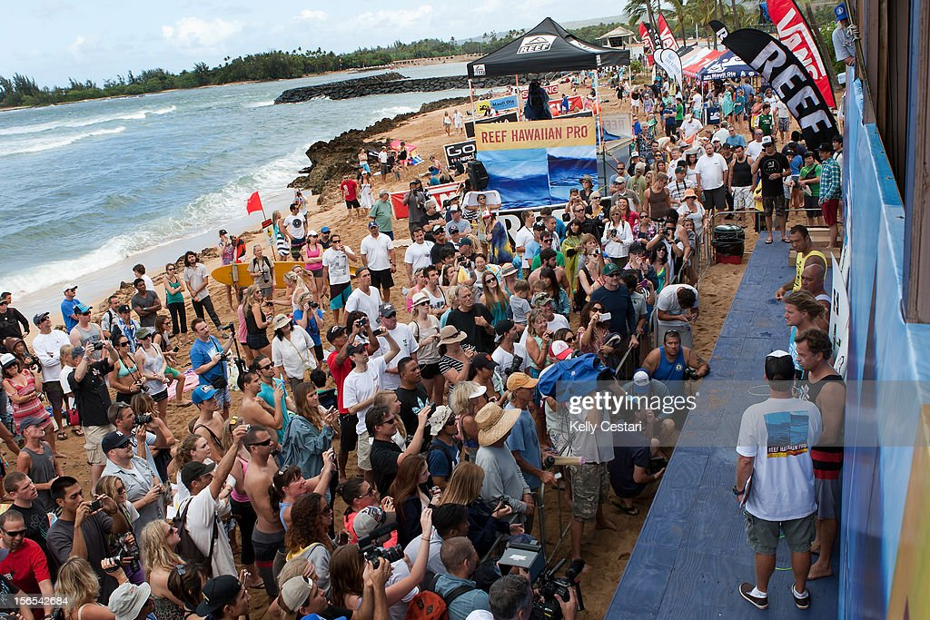 Fans of surfing legends Sunny Garcia and Kaipo Jaquais, both of Hawaii, Mark Occhilupo of Australia and Tom Curren of the United States take the opportunity to get photographs of their surfing heros at the REEF Hawaiian Pro on November 16, 2012 in Haleiwa, Hawaii.