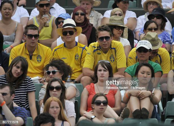 Fans of Sweden's Robin Soderling watch his match against Spain's Marcel Granollers