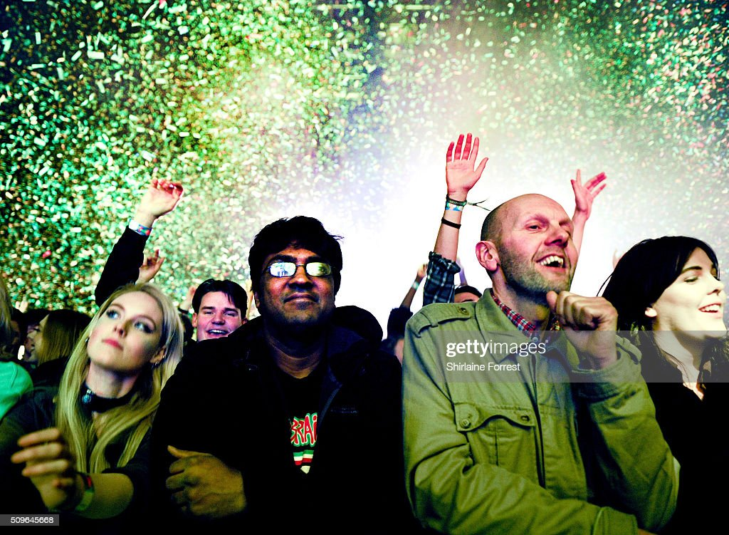 Fans of Tame Impala enjoy the confetti cannons while the band perform at Manchester Arena on February 11, 2016 in Manchester, England.