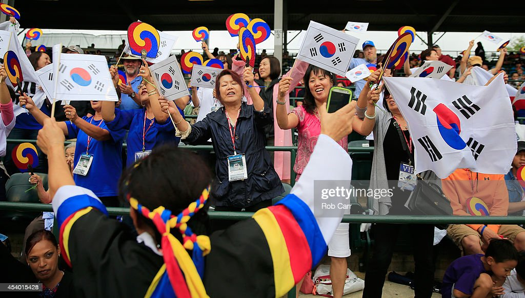 Fans of Team Asia-Pacific cheer between innings against Team Japan during the International Championship game of the Little League World Series at Lamade Stadium on August 23, 2014 in South Williamsport, Pennsylvania.