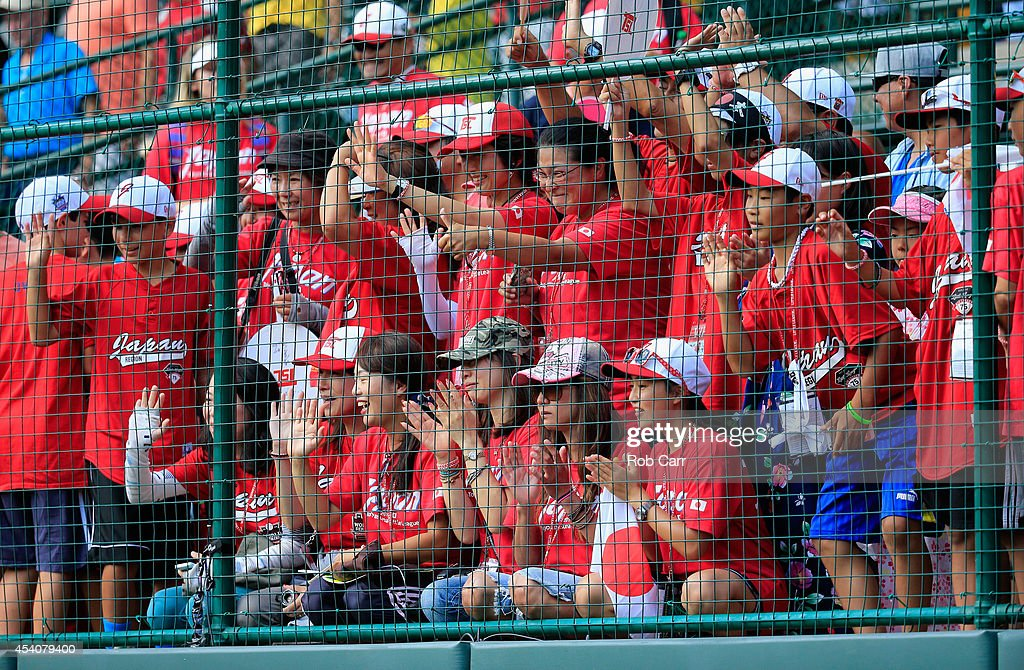 Fans of Team Japan cheer on their team after defeating the West Team from Las Vegas, Nevada during the Little League World Series third place game at Lamade Stadium on August 24, 2014 in South Williamsport, Pennsylvania.