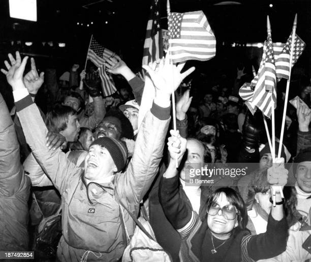 Fans of team USA celebrate in the streets after the team USA defeated the Soviet Union 43 in the semifinal Men's Ice Hockey event at the 1980 Winter...