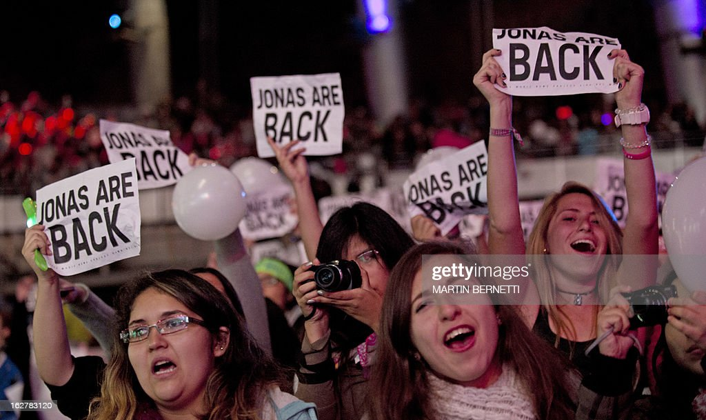 Fans of the American pop rock band Jonas Brothers enjoy the band performace at the 54th Vina del Mar International Song Festival on February 26, 2013 in Vina del Mar, Chile.