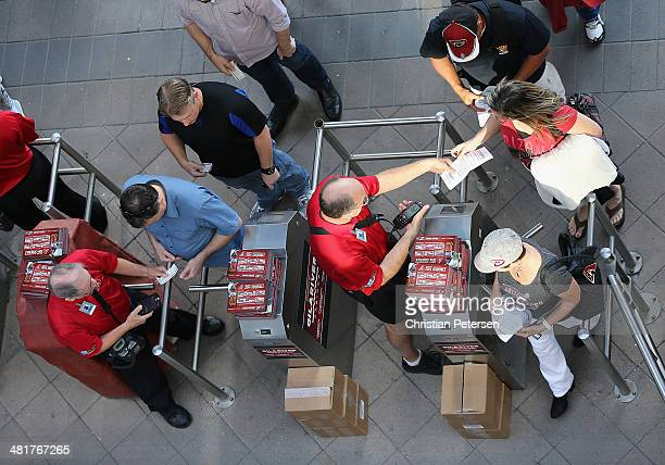 Fans of the Arizona Diamondbacks have their tickets scanned as they arrive to the Opening Day MLB game against the San Francisco Giants at Chase...