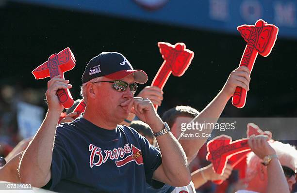 Fans of the Atlanta Braves cheer against the San Francisco Giants during Game Three of the NLDS of the 2010 MLB Playoffs at Turner Field on October...