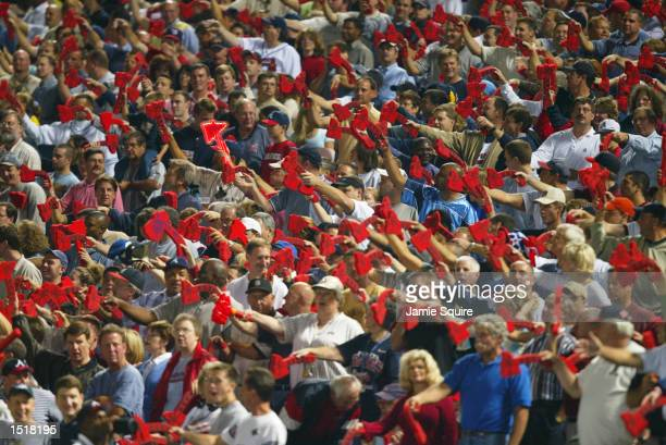 Fans of the Atlanta Braves do the tomahawk chop during game five of the National League Division Series against the San Francisco Giants on October 7...