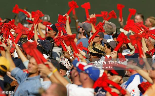 Fans of the Atlanta Braves do the Tomahawk Chop during their game against the Houston Astros in game one of the National League Divisional Series on...