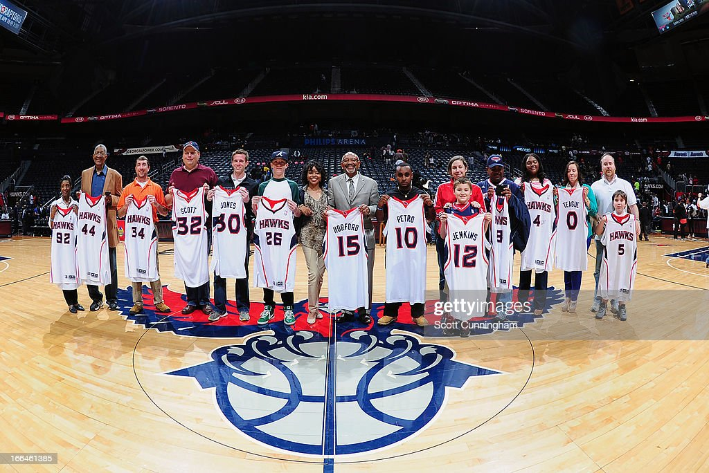 Fans of the Atlanta Hawks line-up after the game to show off their game used jerseys on April 12, 2013 at Philips Arena in Atlanta, Georgia.
