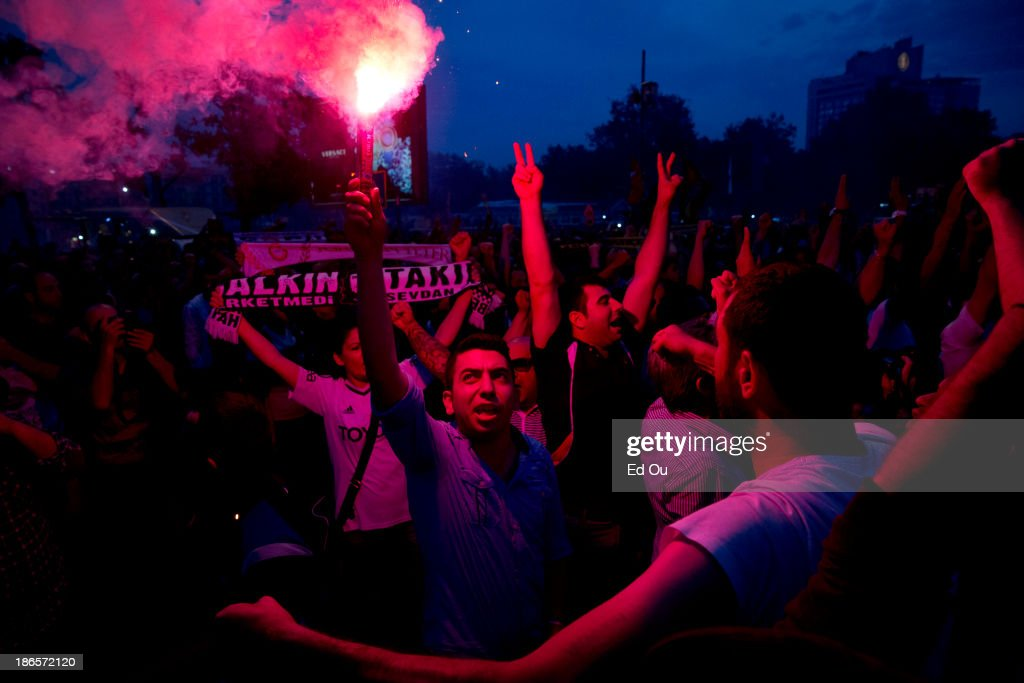 Fans of the Besiktas soccer team light smoke flares in solidarity with antigovernment protesters in Taksim Square in Istanbul Turkey on June 4 2013...