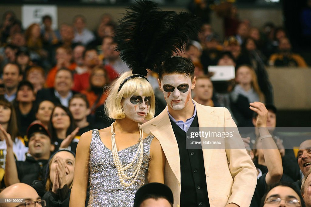 Fans of the Boston Bruins show off their Halloween costumes during the game against the Anaheim Ducks at the TD Garden on October 31, 2013 in Boston, Massachusetts.