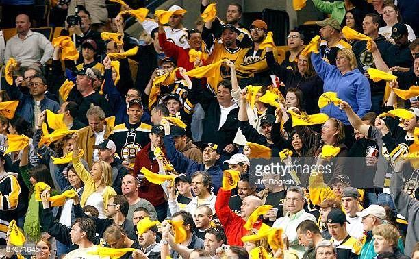 Fans of the Boston Bruins show their support before a game with the Carolina Hurricanes during Game Five of the Eastern Conference Semifinal Round of...