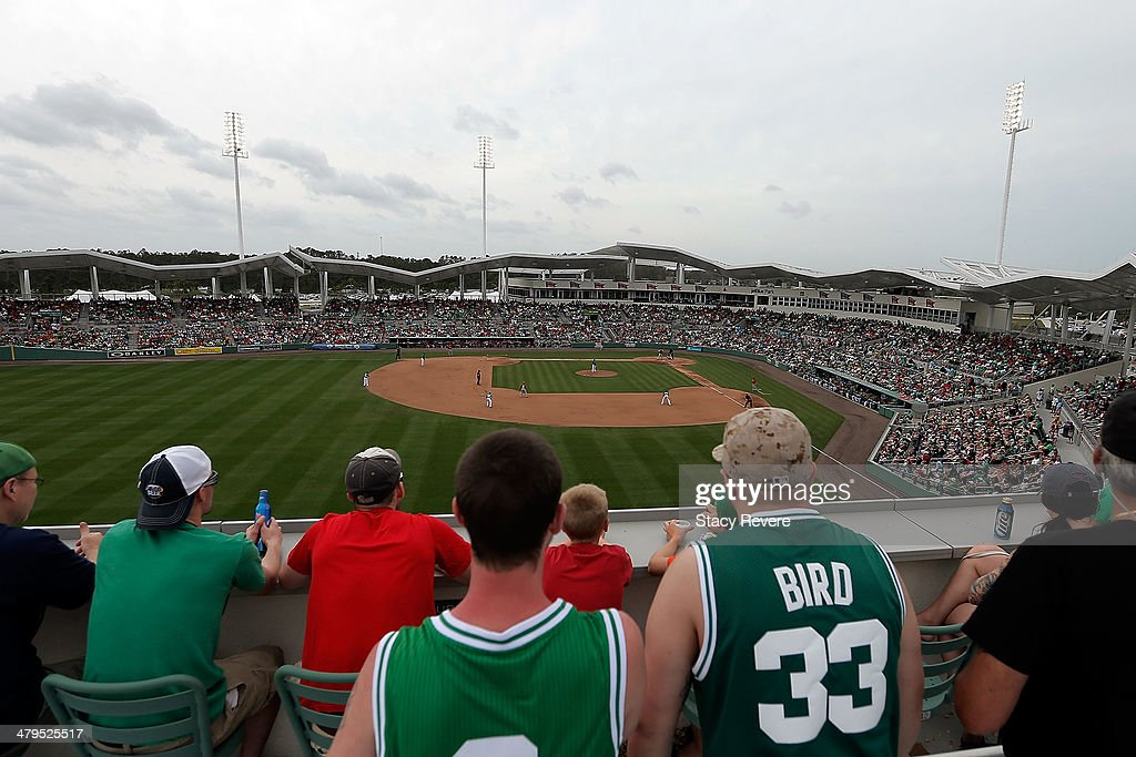 Fans of the Boston Red Sox and the St. Louis Cardinals enjoy a game from the top of the left field wall at JetBlue Park at Fenway South on March 17, 2014 in Fort Myers, Florida. Boston won the game 10-5.