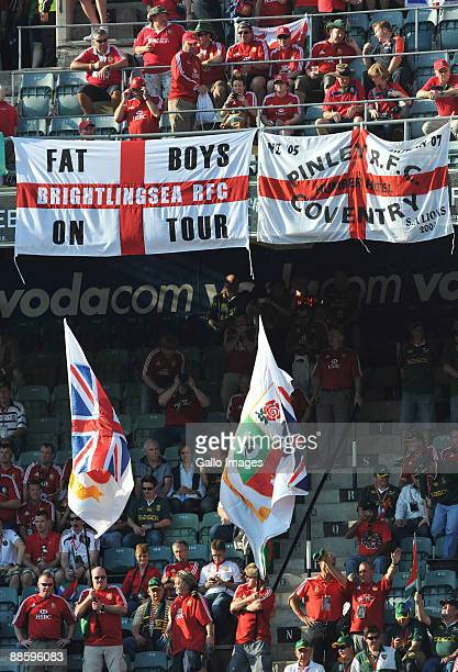 Fans of The British Lions cheers and wave banners during the First Test match between the South African Springboks and the British and Irish Lions at...