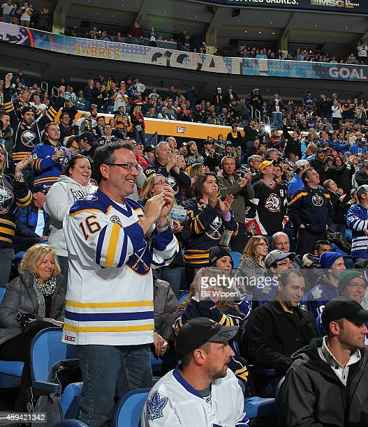 Fans of the Buffalo Sabres celebrate a goal against the Toronto Maple Leafs on November 15 2014 at the First Niagara Center in Buffalo New York