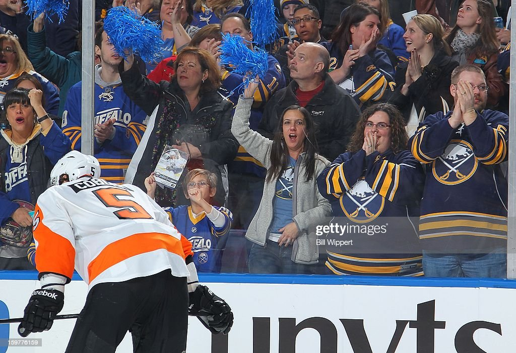 Fans of the Buffalo Sabres celebrate a third period goal against the Philadelphia Flyers on January 20, 2013 at the First Niagara Center in Buffalo, New York. Buffalo defeated Philadelphia, 5-2.