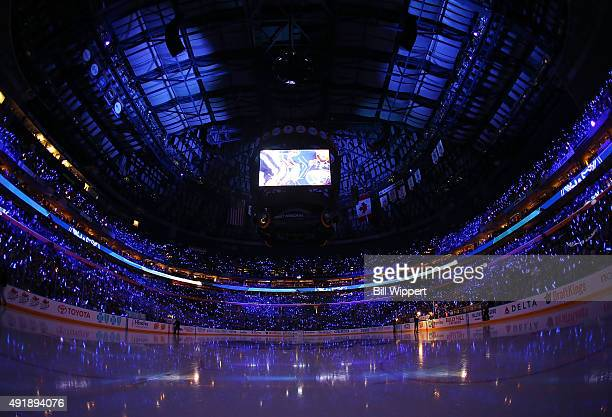 Fans of the Buffalo Sabres hold glow sticks during pregame ceremonies prior to the game against the Ottawa Senators on October 8 2015 at the First...
