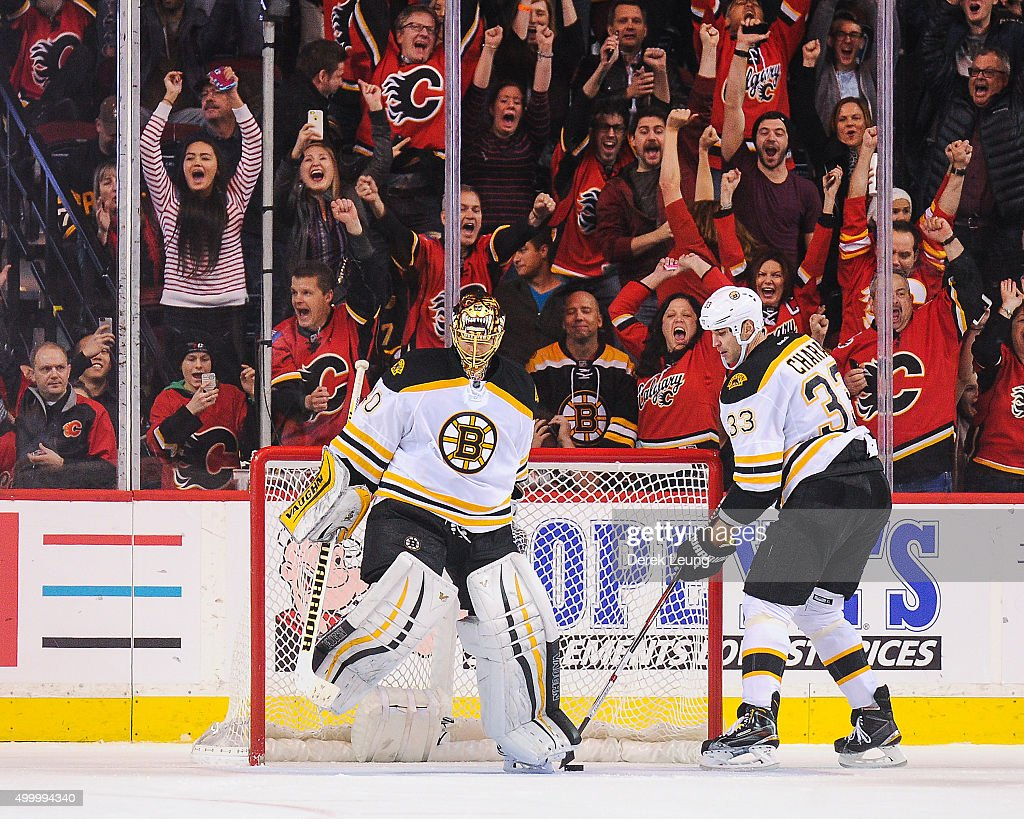Fans of the Calgary Flames celebrate after Johnny Gaudreau #13 (not pictured) scored the game winning goal against Tuukka Rask #40 of the Boston Bruins during an NHL game at Scotiabank Saddledome on December 4, 2015 in Calgary, Alberta, Canada.