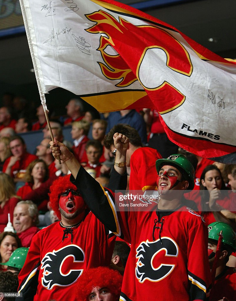 Fans of the Calgary Flames celebrate during Game six of the 2004 NHL Western Conference Finals against the San Jose Sharks during the Stanley Cup Playoffs on May 19, 2004 at the Pengrowth Saddledome in Calgary, Alberta.