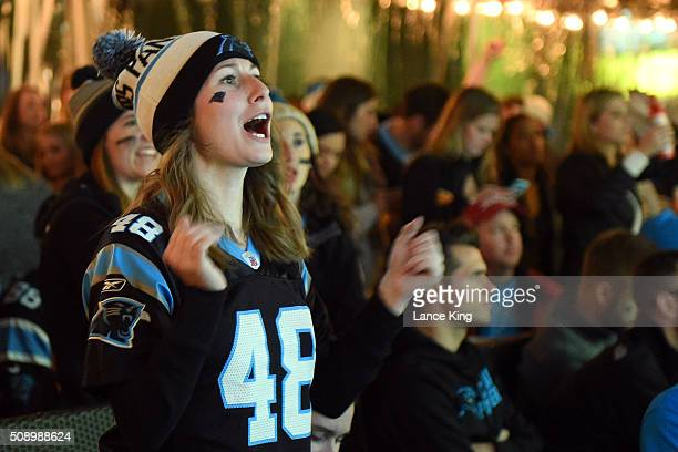 Fans of the Carolina Panthers cheer on their team against the Denver Broncos while watching Super Bowl 50 on February 7 2016 at Rooftop 210 in the...