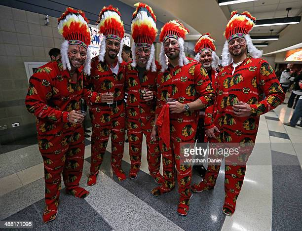 Fans of the Chicago Blackhawks are dressed up for Game Two of the Second Round of the 2014 NHL Stanley Cup Playoffs against the Minnesota Wild at the...