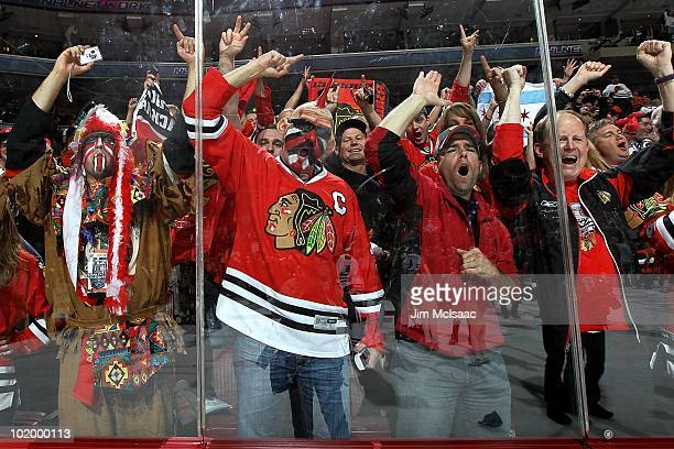 Fans of the Chicago Blackhawks celebrate after the Blackhawks defeated the Philadelphia Flyers 43 in overtime to win the Stanley Cup in Game Six of...