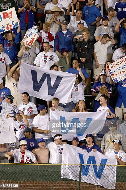 Fans of the Chicago Cubs cheer as they hold up banners during the game against the Chicago White Sox on June 22 2008 at Wrigley Field in Chicago...