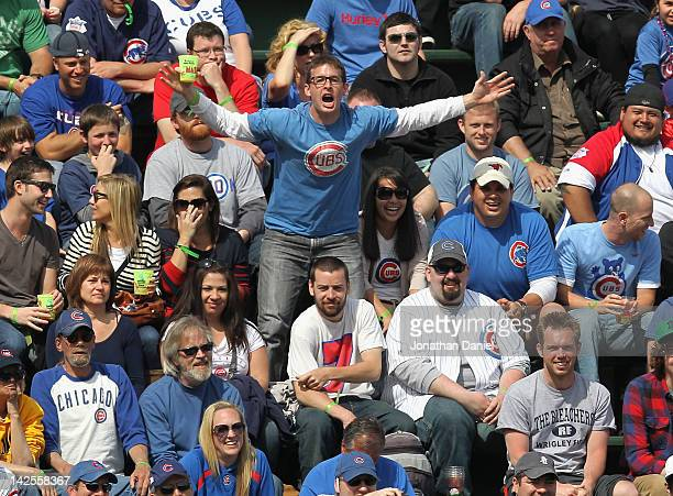 Fans of the Chicago Cubs in the left field bleachers harass Roger Bernadina of the Washington Nationals at Wrigley Field on April 7 2012 in Chicago...