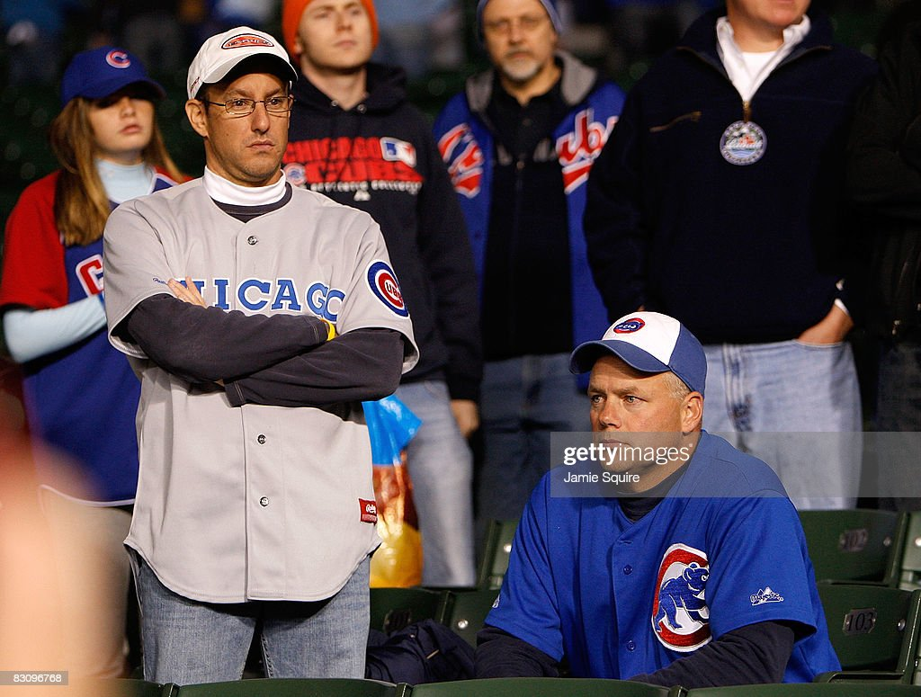 Fans of the Chicago Cubs looks on dejected as the Los Angeles Dodgers beat the Cubs 10-3 in Game Two of the NLDS during the 2008 MLB Playoffs at Wrigley Field on October 2, 2008 in Chicago, Illinois.