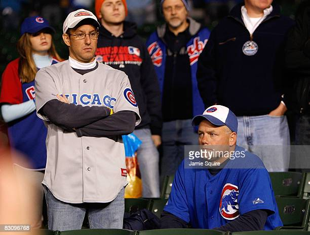 Fans of the Chicago Cubs looks on dejected as the Los Angeles Dodgers beat the Cubs 103 in Game Two of the NLDS during the 2008 MLB Playoffs at...