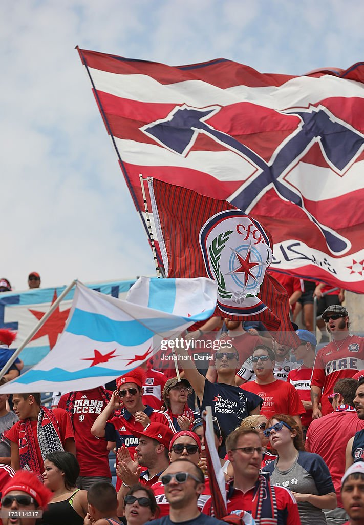 Fans of the Chicago Fire wave flags as the Fire takes on Sporting Kansas City during an MLS match at Toyota Park on July 7, 2013 in Bridgeview, Illinois. Sporting Kansas City defeated the Fire 2-1.