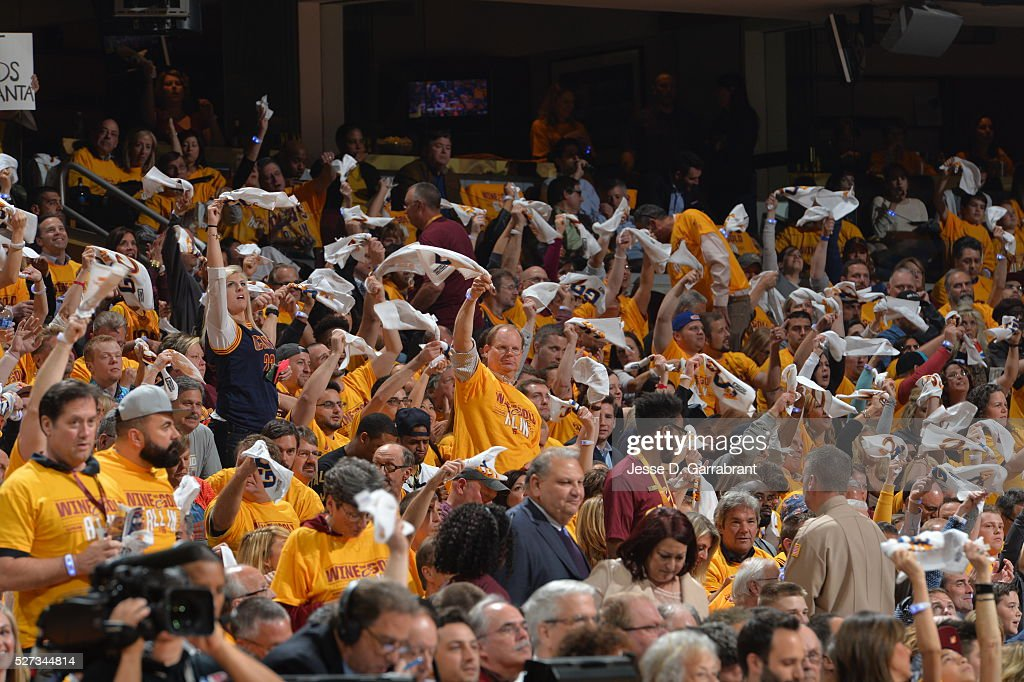 Fans of the Cleveland Cavaliers get pumped up and wave their towels against the Atlanta Hawks during the Eastern Conference Semifinals Game One on May 2, 2016 at The Quicken Loans Arena in Cleveland, Ohio.