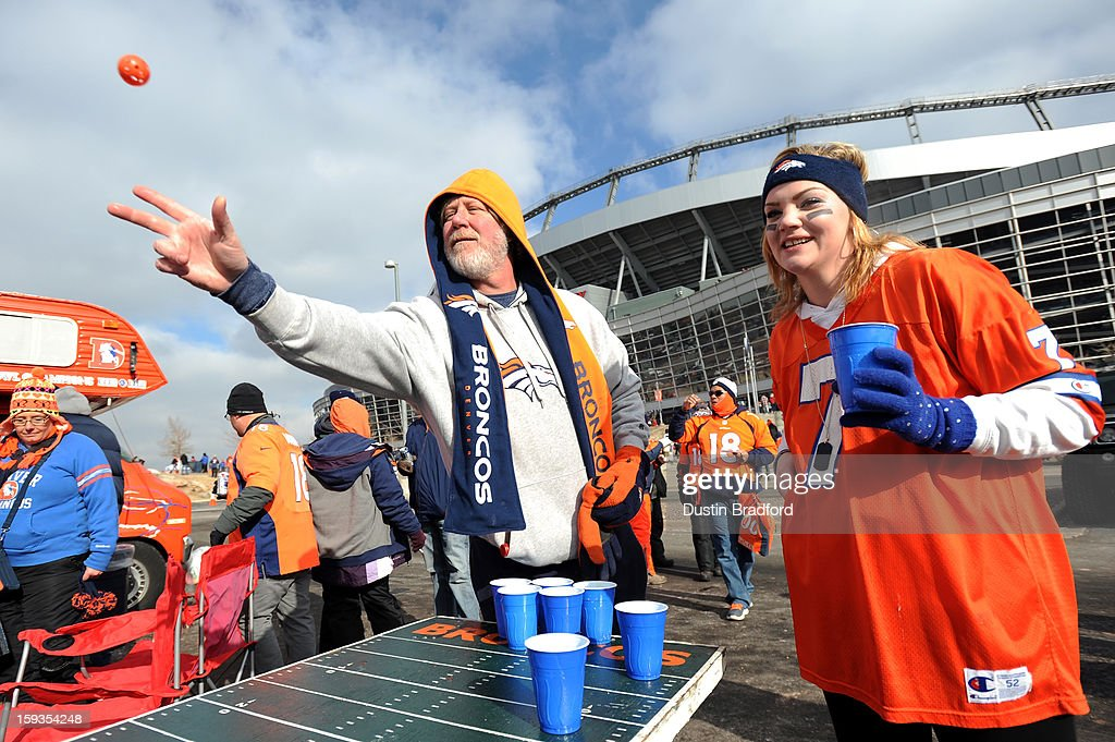 Fans of the Denver Broncos play a ping pong drinking game as they tailgate in the parking lot outside the stadium prior to the Broncos playing the Baltimore Ravens in the AFC Divisional Playoff Game at Sports Authority Field at Mile High on January 12, 2013 in Denver, Colorado.