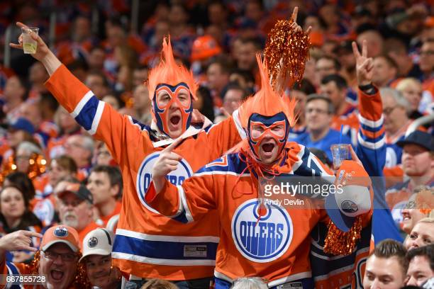 Fans of the Edmonton Oilers celebrate after a goal during Game One of the Western Conference First Round during the 2017 NHL Stanley Cup Playoffs...