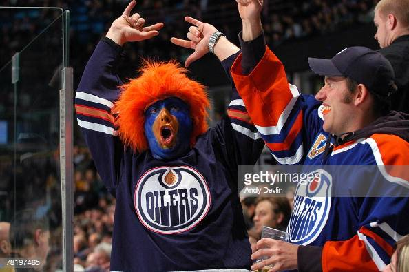 Fans of the Edmonton Oilers celebrate during a game against the Anaheim Ducks at Rexall Place on November 30 2007 in Edmonton Alberta Canada