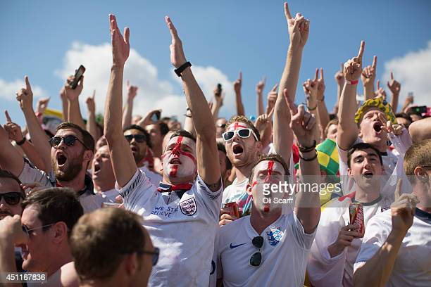 Fans of the England football team cheer as they arrive at the Mineirao Stadium to watch England play Costa Rica on June 24 2014 in Belo Horizonte...