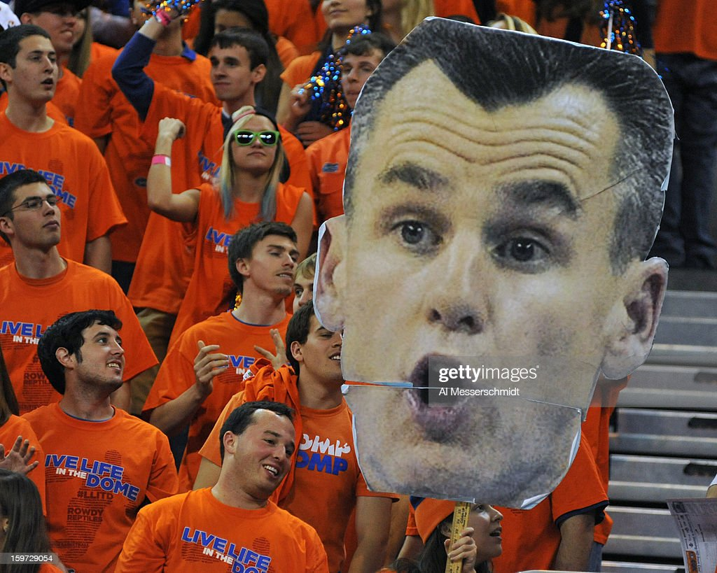 Fans of the Florida Gators display a huge poster of coach <a gi-track='captionPersonalityLinkClicked' href=/galleries/search?phrase=Billy+Donovan&family=editorial&specificpeople=198944 ng-click='$event.stopPropagation()'>Billy Donovan</a> during play against the Missouri Tigers January 19, 2013 at Stephen C. O'Connell Center in Gainesville, Florida. The Gators won 83 - 52 and Donovan scored his 400th win as the Gators coach.