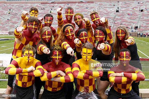 Fans of the Florida State Seminoles pose before the game against the Boston College Eagles at Doak Campbell Stadium on Bobby Bowden Field on November...