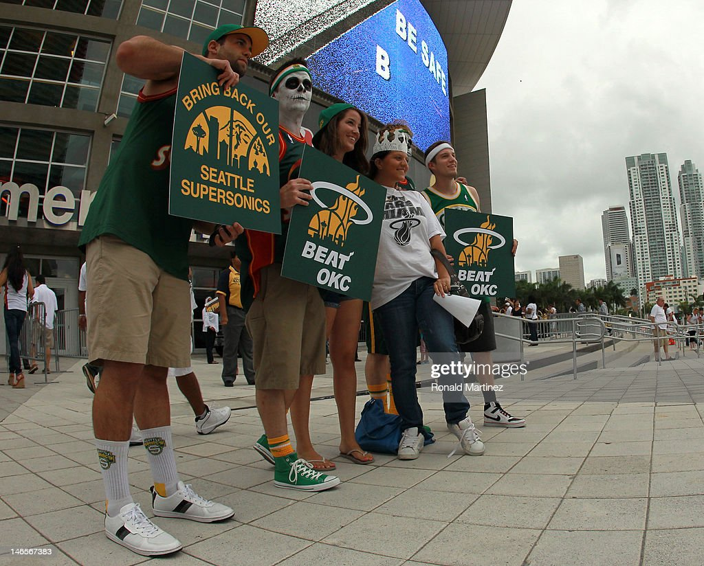 Fans of the former NBA franchise Seattle SuperSonics which moved and became the Oklahoma City Thunder shows support for the Miami Heat to beat the Thunder in Game Four of the 2012 NBA Finals on June 19, 2012 at American Airlines Arena in Miami, Florida.