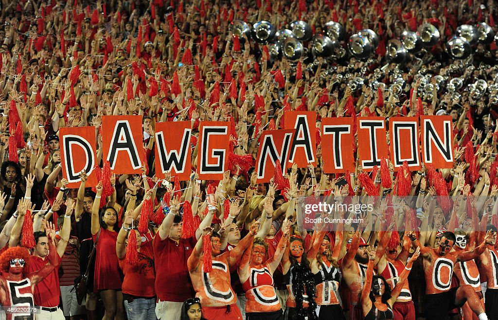 Fans of the Georgia Bulldogs celebrate after a score against South Carolina Gamecocks on September 19 2015 in Atlanta Georgia Photo by Scott...