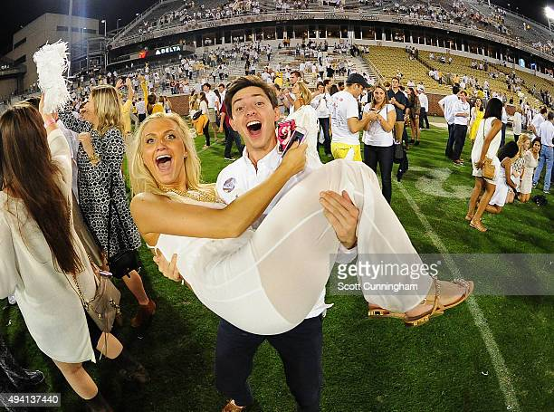Fans of the Georgia Tech Yellow Jackets celebrate at Bobby Dodd Stadium after defeating the Florida State Seminoles on a blocked field goal return...