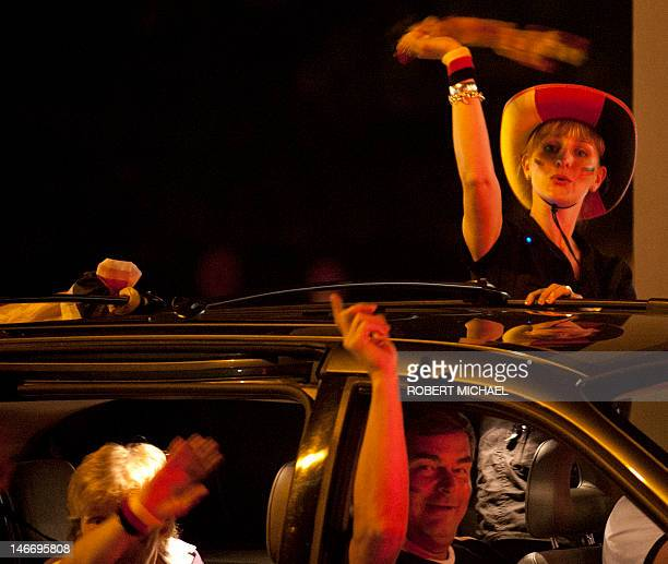 Fans of the German national football team celebrate in a car in Dresden eastern Germany after their team won their EURO 2012 quarterfinal football...