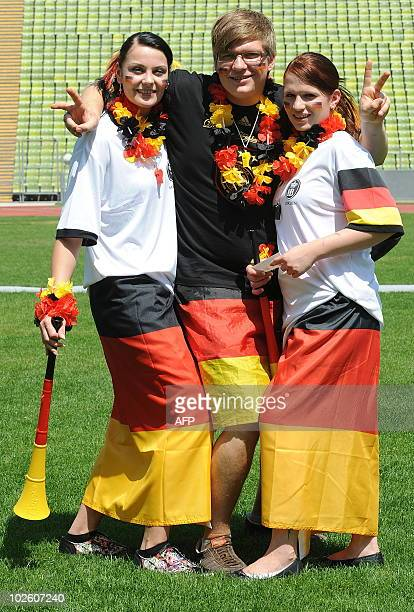 Fans of the German national football team pose prior to a public viewing in Munich southern Germany on July 3 of the FIFA World Cup quarterfinal...