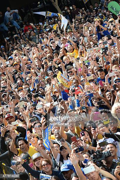 Fans of the Golden State Warriors celebrates winning the 2015 NBA Championship during a parade on June 19 2015 in Oakland CA NOTE TO USER User...