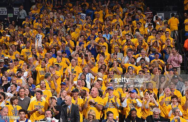 Fans of the Golden State Warriors get pumped up during the game against the Cleveland Cavaliers at the Oracle Arena During Game one of the 2015 NBA...